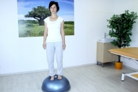 Standing on the round balance pad