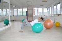 Exercise on a gym ball - strengthening the abdominal muscles