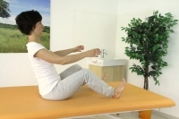 Straightening the spine in sitting position with legs in front