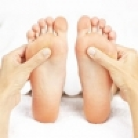 Reflexive therapy of the foot soles
