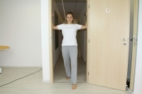 Chest muscle stretching in a doorway